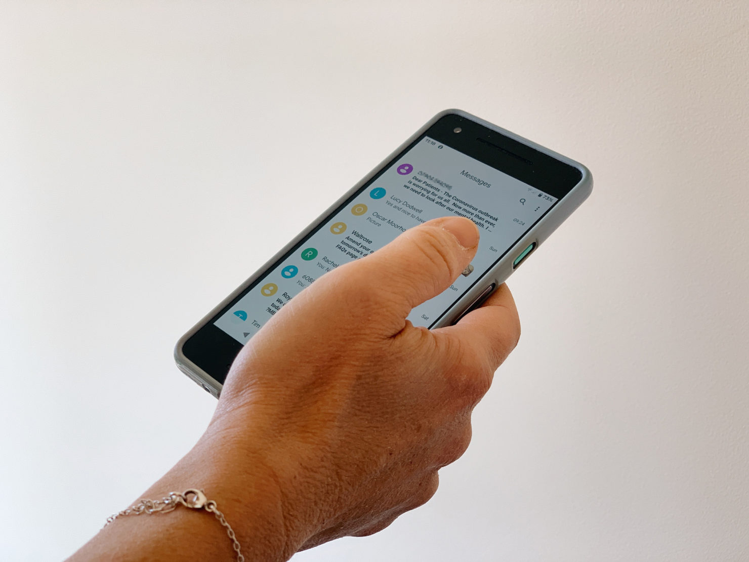 A photograph of someone using text messaging on a smart phone
